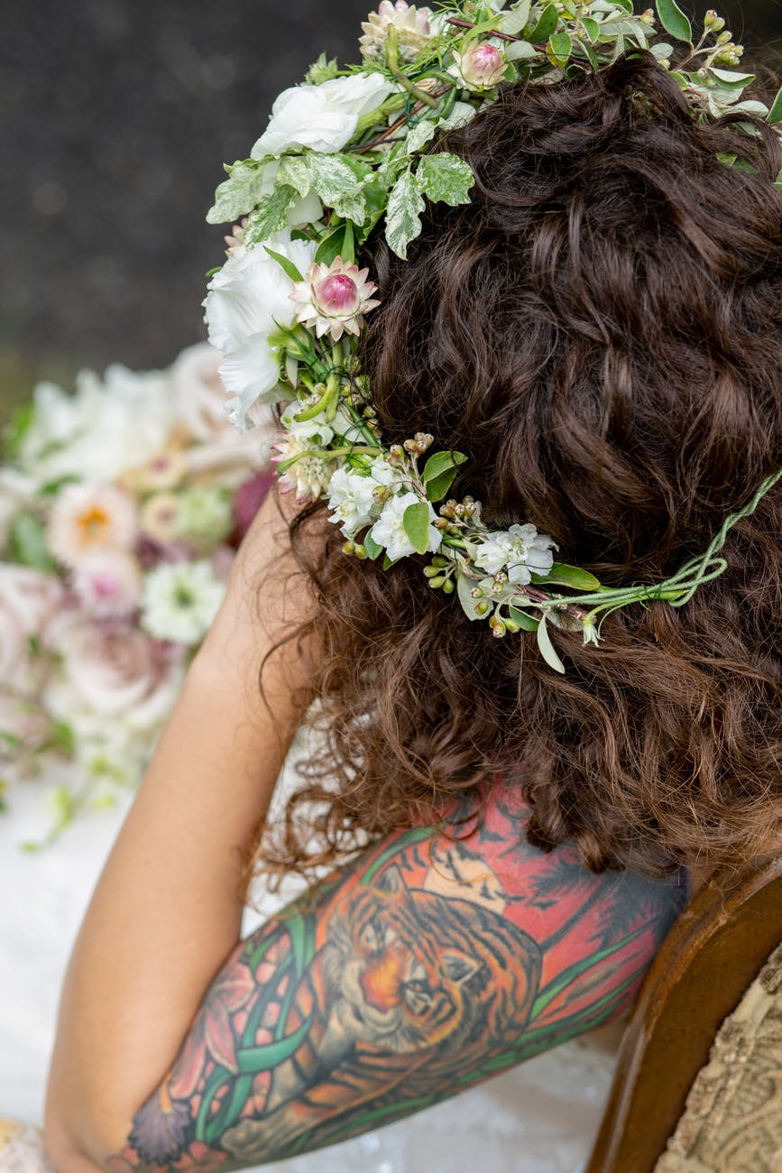 close up photo of woman wearing flower headdress